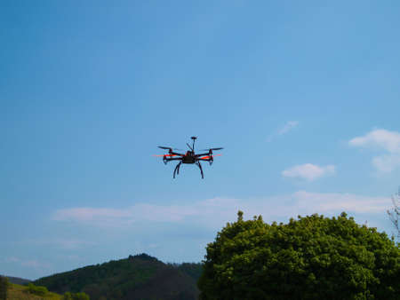 Flying drone in the sky. Banque d'images