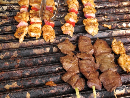 bar b que: Chicken and meat brochettes Stock Photo