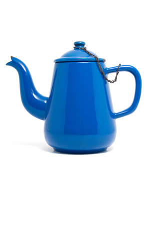 Side shot of a an old blue enameled teapot. photo