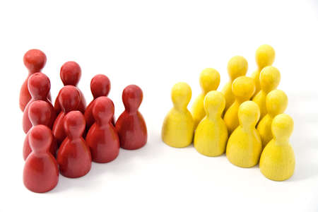 meets: Colored wooden markers on a white background. Red team meets the yellow team.