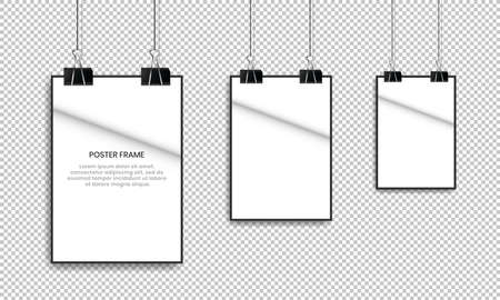 Blank white poster hanging with binder clips.