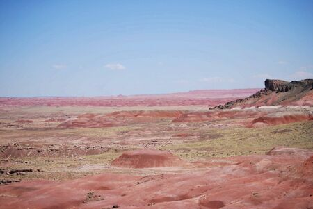 The presence of many minerals in the sand and rock provide a colorful landscape in this desert