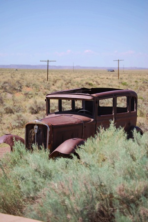 This old car sits abandoned along the path the Route 66 once followed  Stock Photo - 13954099