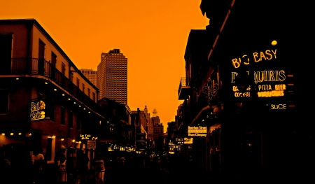 Vivid color creates the feeling of caliente nights on Bourbon Street in the French Quarter of New Olreans.  This is a 1st prize winning image! photo