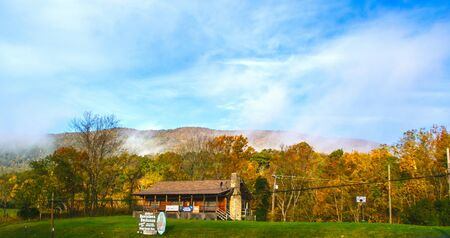 A cabin sits along the interstate in the mountains of North Carolina.