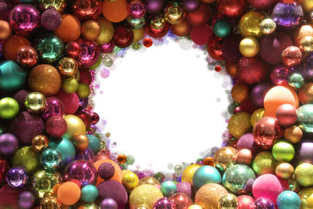Round frame of colorful, differently textured christmas balls, fading into absolute white