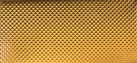 golden triangles in a leather texture in gradual light changes with tiny, wavy outlines