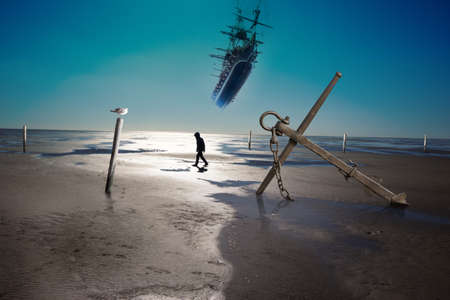 anchor on a coastline with low ebb, and water level poles and a silhouette of walking person, waiting for a flying ship to arrive photo