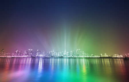 new york city night skyline with a rainbow color change and soft light rays, coming from the bright center Stock Photo