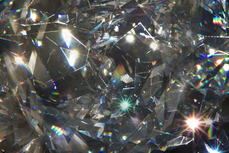 layered diamond closeup light refraction shapes and rays on black                                Stockfoto