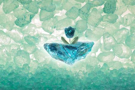 rough diamond: blue diamond cut tulip on a rough ice piece, with transparent stones through back light
