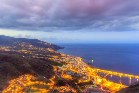 aerial cityl ights at twilight of santa cruz, the capital of la palma, one of the canary isles, in hdr