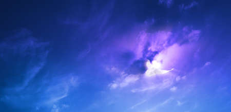 cloudscape with a white dove nearby a sunburst with motion blur lines in the clouds and the wings
