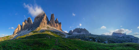 Panoramic of the three peaks, the Cima Grande, Occidentale and Piccola, the landmark of the italian alps, the dolomite mountains at dawn, with the Capella Degli Alpini under them.