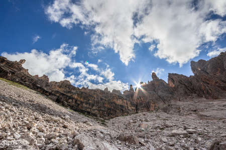 Sunbeam behind the Paternkofel mountain chain in the Dolomites