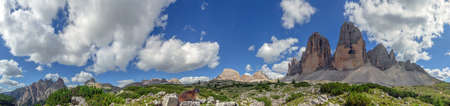 Panoramic view of the Three Peaks, a famous mountain landmark of the Dolomites, with a marmot. Stock Photo