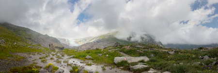 Hiking trail panorama to the Schlatenkees Glacier, part of the Venediger Mountains, at Innergschloess, in the High Tauern National Park. Stock Photo