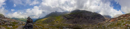 Panoramic view to the Inner Knorrkogel in Tyrol, at the Innergschloess Glacier Trail, with a stack of stones. Stock Photo