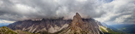 Panoramic clouds over the Sextner Rotwand, a mountain crest in the Dolomites