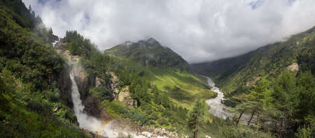 Schlatenkees Waterfall in the Innergschloess Valley, part of the Grossvenediger Mountains in the European Alps, with an appearing rainbow