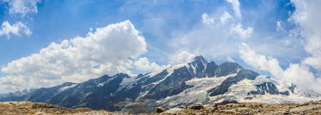 Wide view of the Grossglockner Mountain range with parallel clouds movement, showing the largest peak of Austria in all its glory