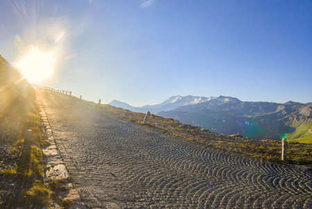 The High Tauern Road is leading to the rising sun at the Edelweissspitze viewing point
