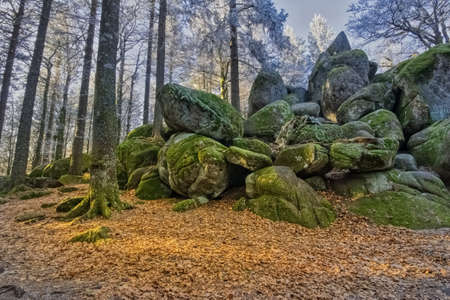 The Guenterfelsen, a Giant rock formation with autumn foliage, in the Simonswald, on the Brend Way, in the Black Forest, Southwest Germany Stock Photo