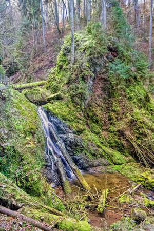 Lotenbachklamm Waterfall with a wooden bridge in the Wutach Gorge, in the Black Forest, Southwest Germany
