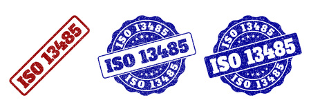 ISO 13485 grunge stamp seals in red and blue colors. Vector ISO 13485 labels with scratced surface. Graphic elements are rounded rectangles, rosettes, circles and text labels.