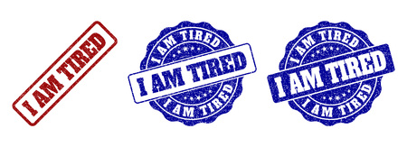I AM TIRED scratched stamp seals in red and blue colors. Vector I AM TIRED labels with scratced surface. Graphic elements are rounded rectangles, rosettes, circles and text labels.