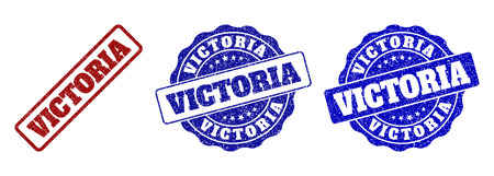 VICTORIA scratched stamp seals in red and blue colors. Vector VICTORIA labels with distress effect. Graphic elements are rounded rectangles, rosettes, circles and text labels.