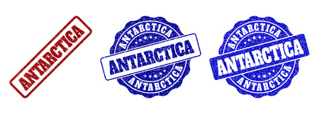 ANTARCTICA grunge stamp seals in red and blue colors. Vector ANTARCTICA labels with dirty effect. Graphic elements are rounded rectangles, rosettes, circles and text labels.