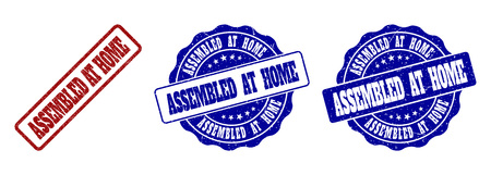 ASSEMBLED AT HOME grunge stamp seals in red and blue colors. Vector ASSEMBLED AT HOME labels with scratced surface. Graphic elements are rounded rectangles, rosettes, circles and text titles.