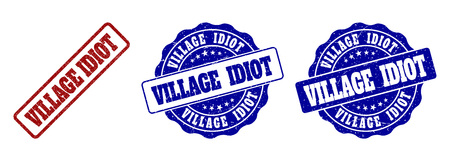 VILLAGE IDIOT scratched stamp seals in red and blue colors. Vector VILLAGE IDIOT labels with dirty style. Graphic elements are rounded rectangles, rosettes, circles and text labels.