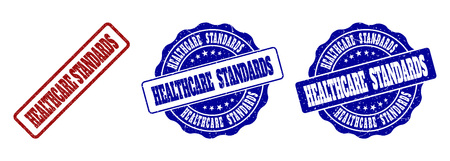 HEALTHCARE STANDARDS scratched stamp seals in red and blue colors. Vector HEALTHCARE STANDARDS imprints with dirty surface. Graphic elements are rounded rectangles, rosettes,