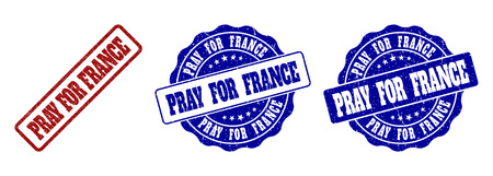 PRAY FOR FRANCE scratched stamp seals in red and blue colors. Vector PRAY FOR FRANCE labels with dirty surface. Graphic elements are rounded rectangles, rosettes, circles and text labels.