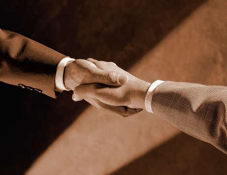 don hammond: Handshake over unfocused arm