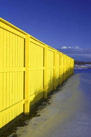 don hammond: Bright yellow wall with blue sky and snow