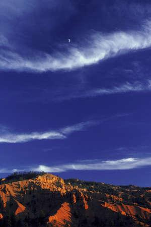 cirrus: Bands of cloud above desert mountain Stock Photo
