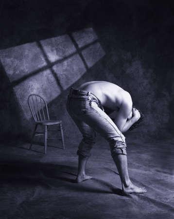 esclavo: Un hombre en angustia  Foto de archivo