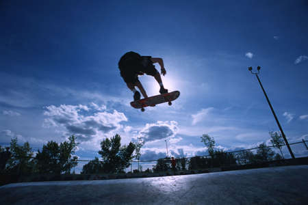 Skateboarder at skate park photo