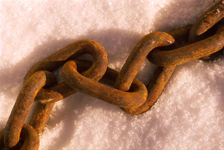 corey hochachka: Rusted link chain on snow