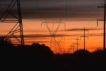 Sunset by parallel power lines