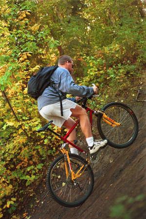 trail bike: Man riding trail bike in forest
