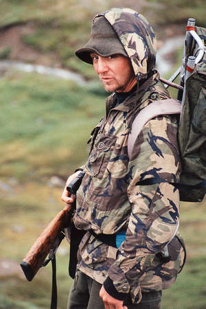 corey hochachka: Man with gun in camouflage clothing