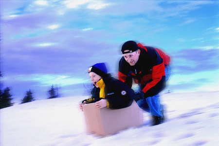 corey hochachka: Boy in box being pushed downhill