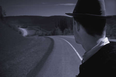 Man in hat standing by road