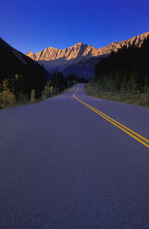 carson ganci: Two lane highway in narrow mountain valley