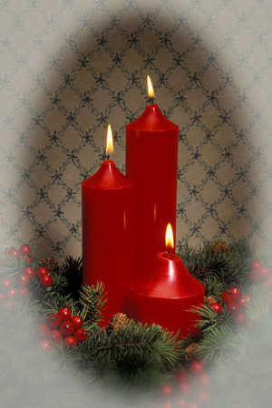 Candles with holly berries Stock Photo