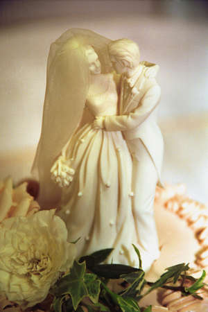 topper: Figurine of bride and groom on wedding cake